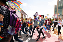 Group Of Students With Rainbow...