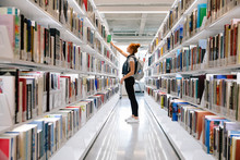 Student Reaching For Book On L...