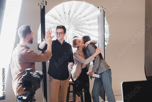 selective focus of model, stylist, hairstylist and photographer showing yes gest Canvas Print