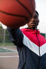 Basketball Player Holding Ball And Facing Camera Close Up