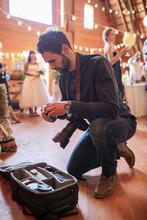 Male Photographer Preparing Ca...