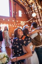 Happy Wedding Guest Hugging Br...