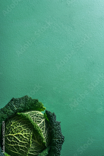 Savoy cabbage freshly harvested on a green table. Detox food Fototapete
