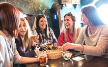 Happy Women Drinking Beer At B...