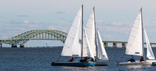 Three Two Person Sailboats With The Great South Bay Bridge In December