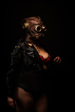 Portrait Of A Young Sexy Woman Wearing A Futuristic Gas Mask