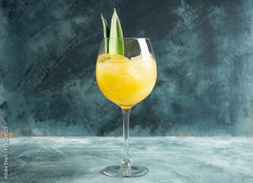 Cuadros en Lienzo  Pineapple cocktail in wine glass