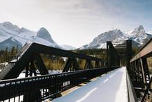 Snow Covered Bridge Below Mountains