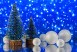 Leinwanddruck Bild - Christmas composition with Christmas trees and decorative snowballs against holiday lights background