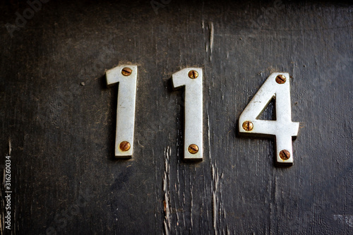 House number 114 Wallpaper Mural
