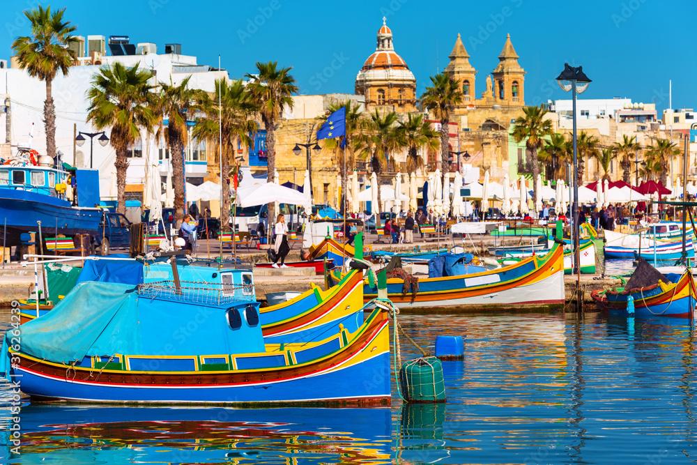 Fototapeta Traditional fishing boats in the Mediterranean Village of Marsaxlokk, Malta