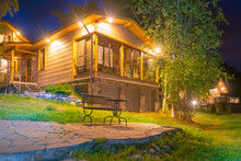 Wooden Cottage With A Large Gl...