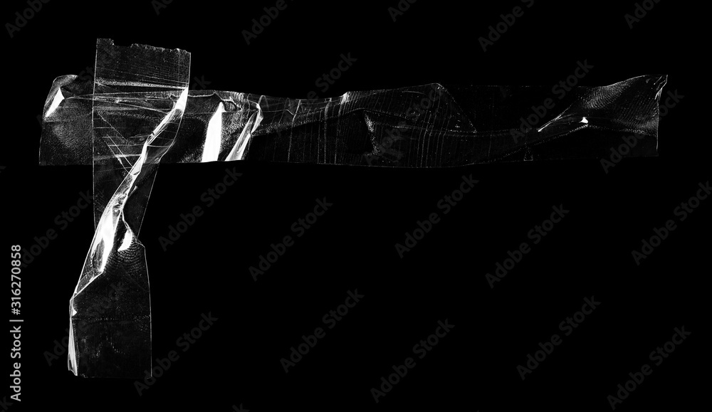Fototapeta Transparent adhesive tape isolated on black background, with clipping path