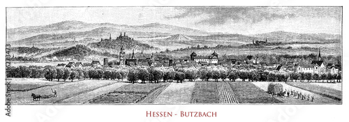 Germany, Hessen - Butzbach and its valley. The Heidelbeerberg overlooks the town, another mountain nearby is the Hausberg. In the town old frame houses and the landgraves' castle
