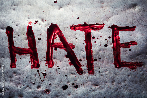 The word hate painted by blood on a metal table Tapéta, Fotótapéta