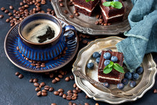 Close-up Of Cup Of Coffee And Chocolate Cakes