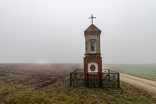 Shrine With A Cross In The Fog...