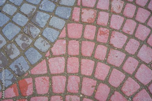 Carta da parati Natural background of multicolored paving stones