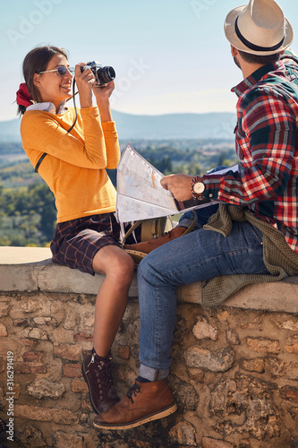 Fototapeta tourists travelling and enjoying on vacation,