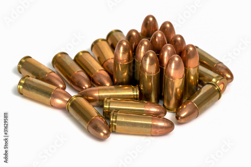 Pile of 9mm bullets on a white background. Image Canvas Print