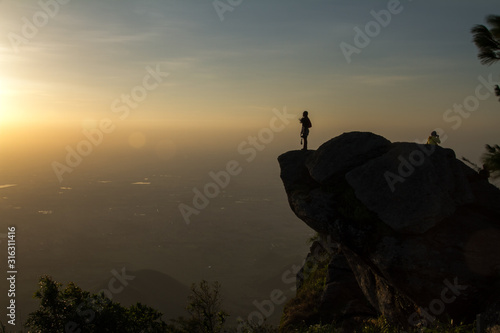 Fototapety, obrazy: silhouette of man on top of mountain