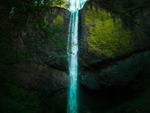 Blue Green Waterfall From Behi...