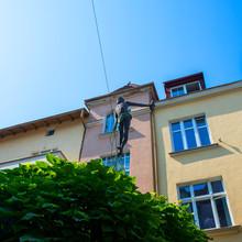 Tightrope Walking Fisherman In Sopot