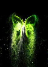 光輝く抽象的な蝶から粒子が飛び散る