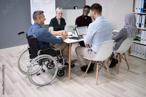 Obraz Disabled Businessman In Conference Room - fototapety do salonu