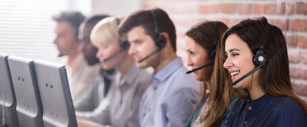 Fototapeta Female Customer Services Agent In Call Center