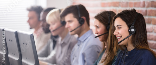 Obraz Female Customer Services Agent In Call Center - fototapety do salonu