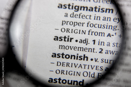 Photo The word or phrase astir in a dictionary.