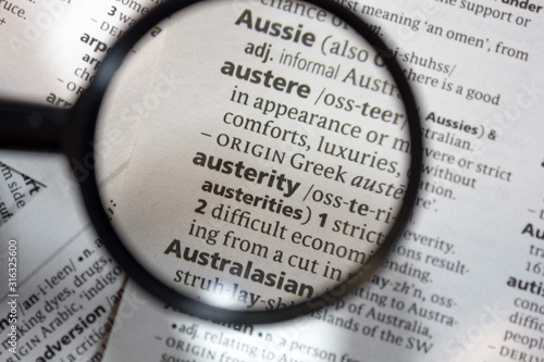 Photo The word of phrase - austerity - in a dictionary.
