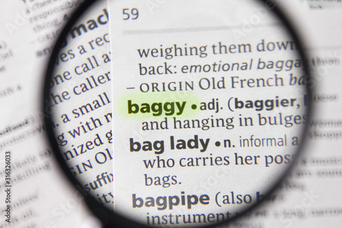 Photo The word or phrase baggy in a dictionary.