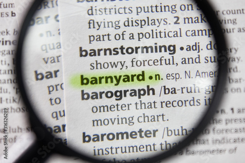 Photo The word or phrase barnyard in a dictionary.