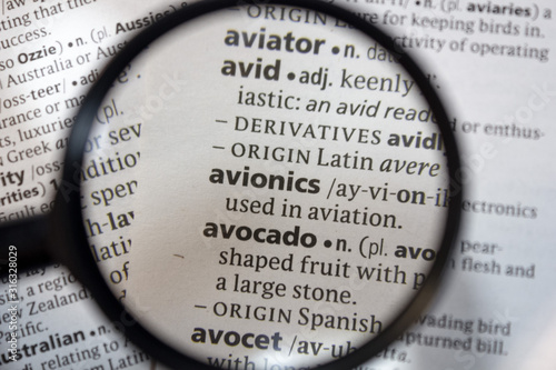 Photo The word of phrase - avionics - in a dictionary.