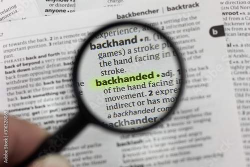 The word or phrase backhanded in a dictionary. Wallpaper Mural