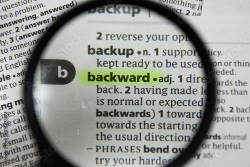Photo The word or phrase backward in a dictionary.