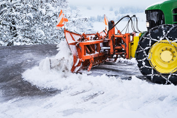 Tractor Cleaning Road From Snow