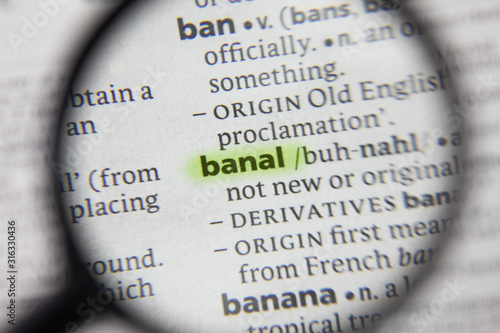 Photo The word or phrase banal in a dictionary.