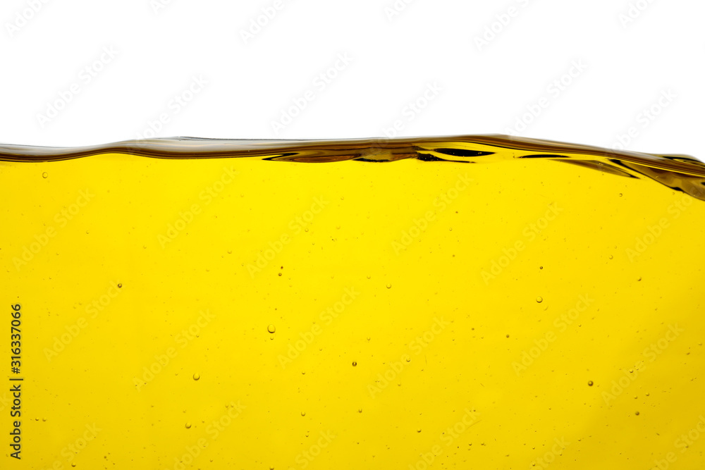 Fototapeta Cooking oil flow isolated on white. Color liquid