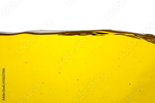 Cooking oil flow isolated on white. Color liquid