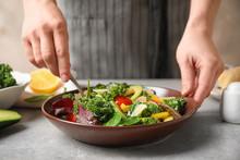 Woman Cooking Tasty Kale Salad...