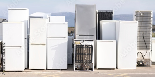 Old fridge freezer refrigerator refrigerant gas at refuse dump skip recycle stac Wallpaper Mural