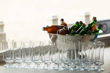 Many Empty Glasses In A Row. Glasses For Beer And Water. Bottled Beer Chilling. Party, Banquet, Ceremony, Celebration