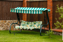 Outdoor Cosy Bench Swing. Garden Swing With Roof And Pillows For Relax