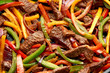 canvas print picture - Beef Steak Fajitas with mix pepper, onion and avocado on wooden board