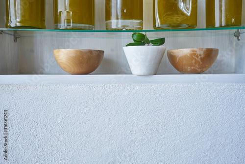 Fototapeta copy space kitchen shelf detail olive oil bottle kitchen closeup glass bowl deco bottles oils gold food cooking natural organic bowl obraz