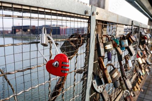 KRAKOW, POLAND - JANUARY 13, 2020: The Kladka Bernatka- bridge of love with love padlocks