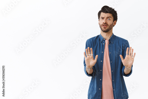 Photo Worried guy doesnt like how offer sounds, trying avoid bad affairs, shaking hand